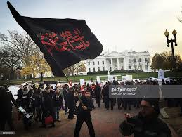 Black White Black Flag A Shia Muslim Waves A Giant Black Flag In Protest Against Isis And