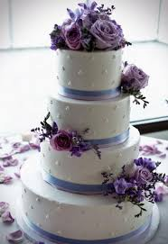 white 4 tier wedding cake with lavender light purple flowers jpg