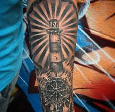 custom black and grey lighthouse tattoo by salvador diaz at