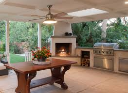 outdoor entertainment area with wood burning fireplace bbq and