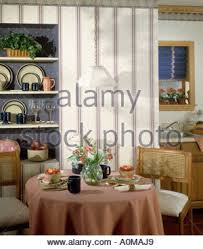 dining corner table set for two food drink candles curtains salad