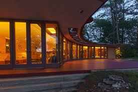 lakefront frank lloyd wright house with original furniture returns