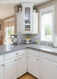 Just Cabinets And More by White Kitchen Reveal Grey Corner Cabinets And Grey Countertops