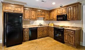 Maple Kitchen Cabinet by Maple Kitchen Cabinets With Black Appliances Kitchen Go Review