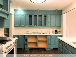 kitchen cabinets without toe kick my freshly painted teal kitchen cabinets