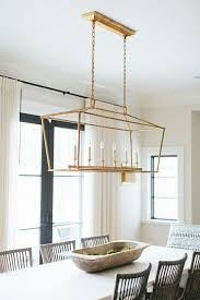 Lantern Lights Over Kitchen Island by French Style Dining Area In Kitchen With Linen Covered Wooden Bar