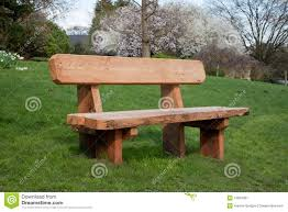 wooden bench on grass stock image image 13819391