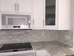 kitchen glass front cabinet design with quartzite countertops