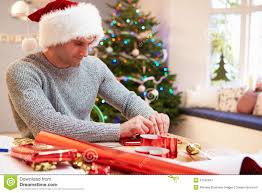 man wrapping christmas gifts at home stock photo image 41520847