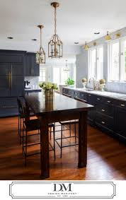 the kitchen cabinet company charcoal gray kitchen wood island brass fixtures hardware for