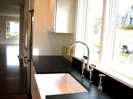solid surface farmhouse sink paperstone counter farmhouse sink white cabinets kitchen design