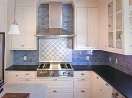 backsplashes blue glass subway tile kitchen backsplash white flat blue glass subway tile kitchen backsplash white flat cabinet glass doors stainless steel wall mounted range hood black granite countertop