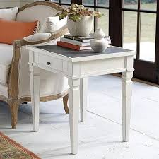 distressed white side table and gray porcelain top side table