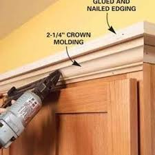 add molding shelving to the top of your kitchen cabinets