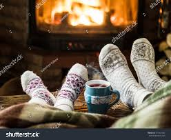 warming relaxing near fireplace mother daughter stock photo