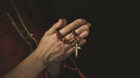 praying with rosary in stock of