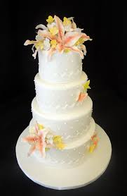 cake fiction stargazer lily wedding cake with lace ribbon and