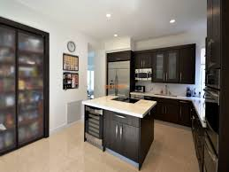 in line kitchen remodeling miami with dark cherry wood cabinets