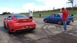 porsche 911 turbo 90s sport cars drag race 911 turbo s subaru sti with loop