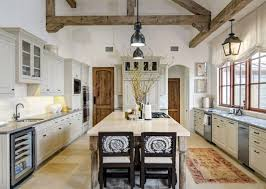 rustic spanish kitchen design wooden island wood dark floor blue