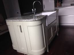 kitchen island with belfast sink swan tap and granite worktop