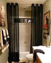 floor to ceiling shower curtains make a small bathroom feel more