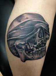 black and gray skull with bandana covering eyes tattoo mike riedl
