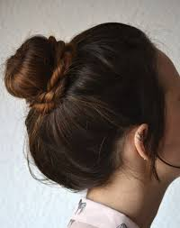 different hairstyles in buns 10 new bun hairstyles to try in 2018 purewow