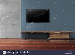 led tv on dark blue wall with wooden furniture in empty living led tv on dark blue wall with wooden furniture in empty living room modern loft style