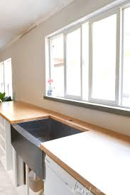 kitchen with white cabinets and wood countertops how to build seal wood countertops houseful of handmade