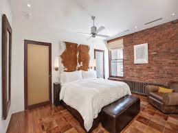 bedroom open plan apartment with exposed wood beams and iron