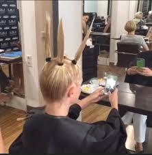 fem boys at the hair salon hairdresser at m m friseure salon pulls woman s locks into four