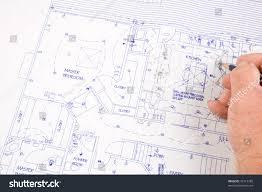 closeup architect making changes house plans stock photo 42713788