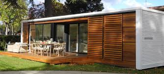 architecture smaal prefab home with wooden table and chairs in