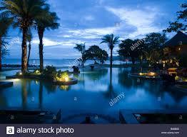 main pool at night hotel shanti ananda resort und spa mauritius