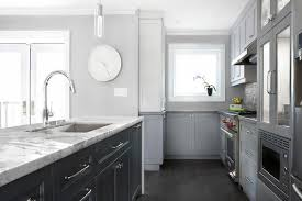 White Island Light Light Gray Cabinets With Dark Gray Kitchen Island Transitional