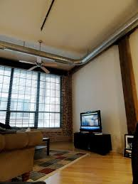 How To Design Your Apartment by Inspiring Small Living Room With Industrial Style And Ceiling Fan