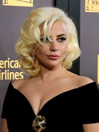 lady gaga without tattoos see the pictures at the golden globes
