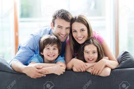 Family Home Family Sitting On Couch Stock Photo Picture And Royalty Free