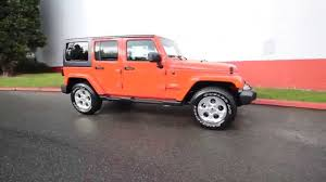 orange jeep 2015 jeep wrangler unlimited sahara sunburst orange fl651936