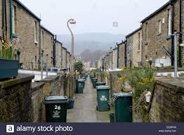 the back alley full of wheelie bins in the traditional victorian