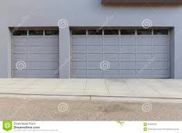 three car garage door on slop stock photo image 66539969