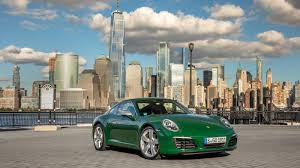 irish green porsche gaze at the beautiful one millionth porsche 911 gracing new york city