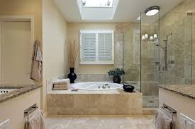 white bathroom vanity with marble top mirror above double round