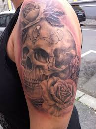 collection of 25 feminine flowers and skull tattoos on arm