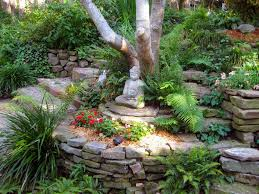 asian landscape and yard with raised beds pathway in rock