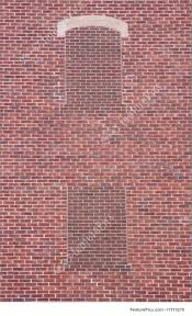 brick wall with two blind windows photo
