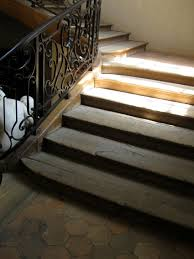 interior stylish under stairs storage with wooden footing ladder