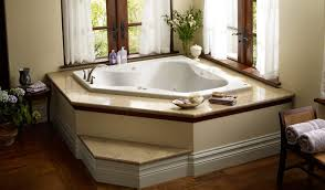 bathroom corner jacuzzi tub with shower area opened flotaed shelf corner jacuzzi tub with white curtains round table rattan chair and decorative plants full