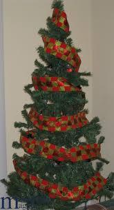criss cross ribbon christmas tree christmas lights decoration